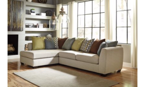 photo of an Ashley Furniture sofa set with throw pillows