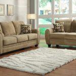 Homelegance-Rubin-2-Piece-Living-Room-Set-in-Light-Brown-Microfiber to illustrate leather sofas vs. fabric sofas