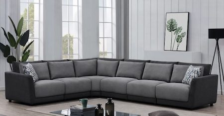 A modern sofa sectional that is gray with black trim