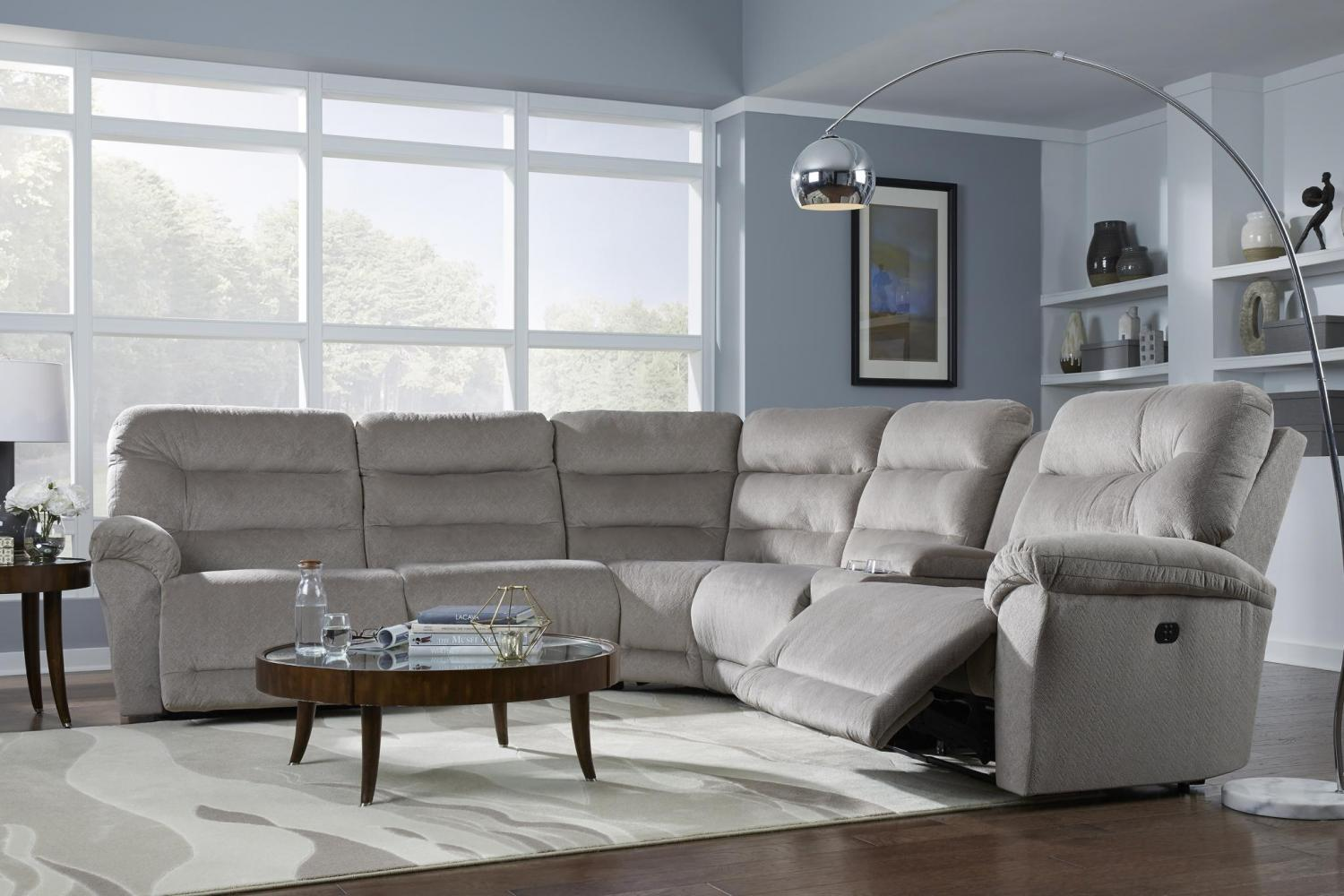 living room sofa with gray blue walls to illustrate brighten up your living room