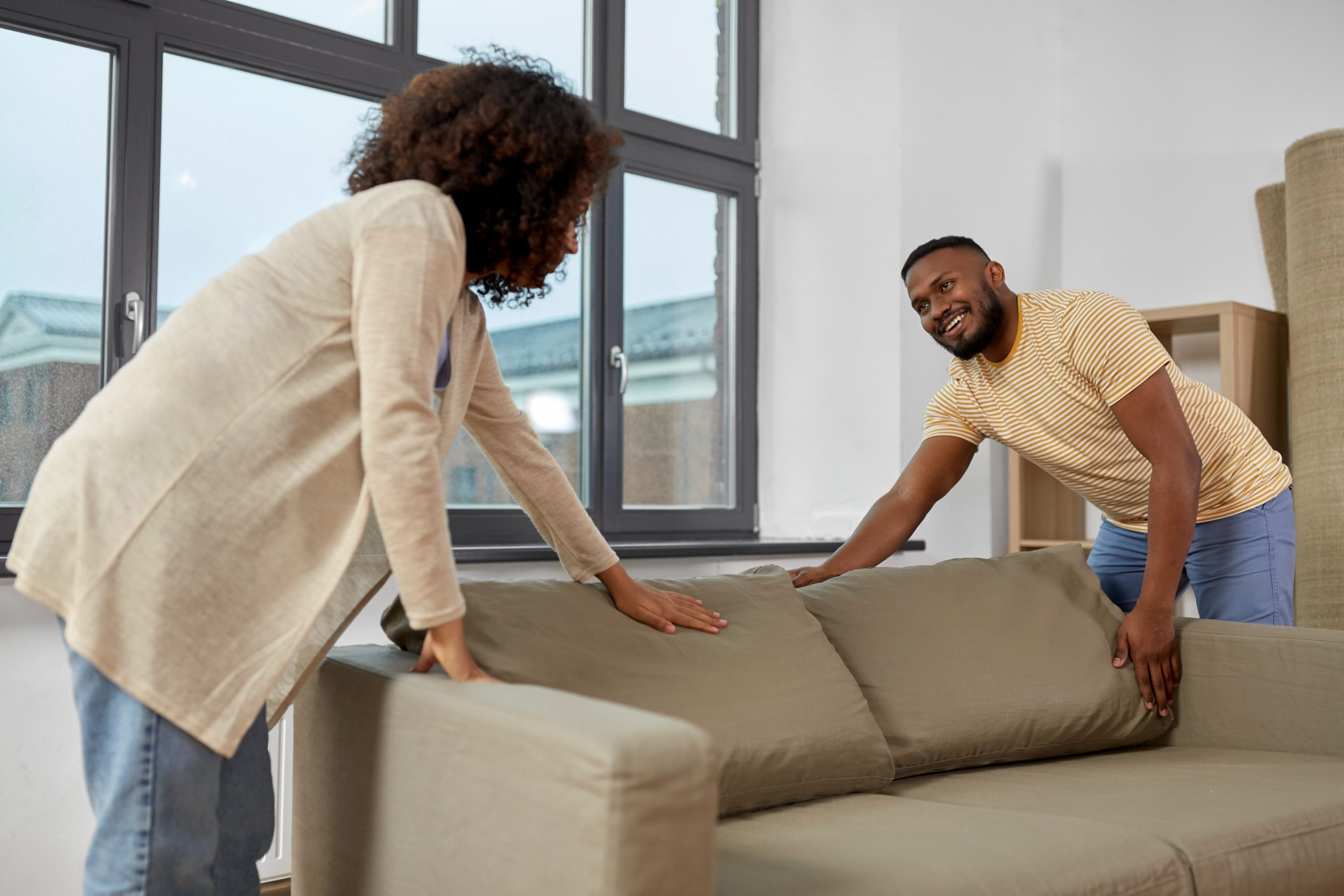 happy black couple moving to new home to illustrate How To Design The Perfect Room